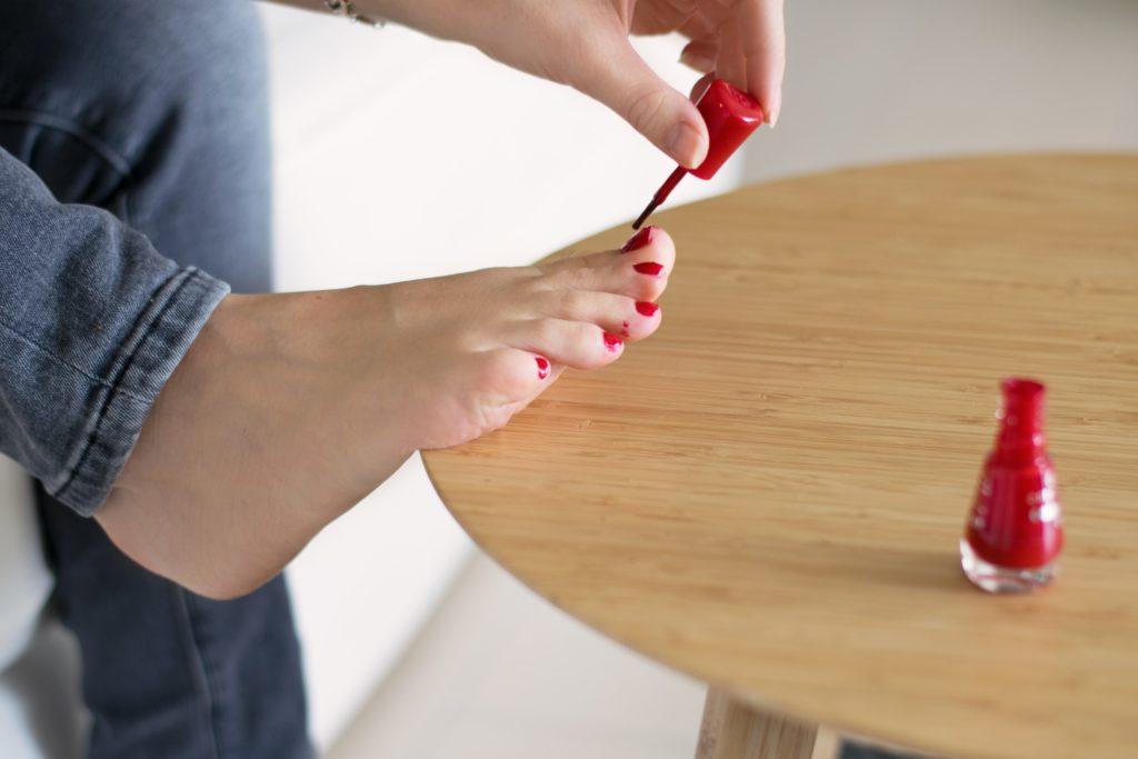 Painting toenails.